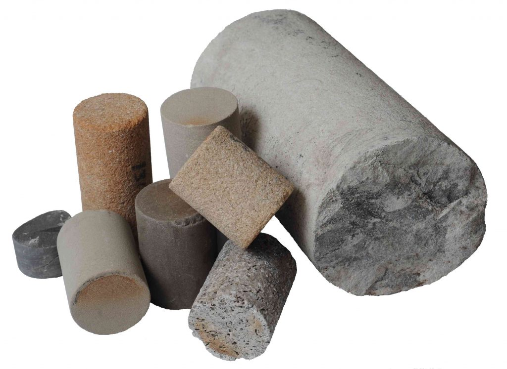Image of various types of rock core samples including shale with fracturing in their pore networks
