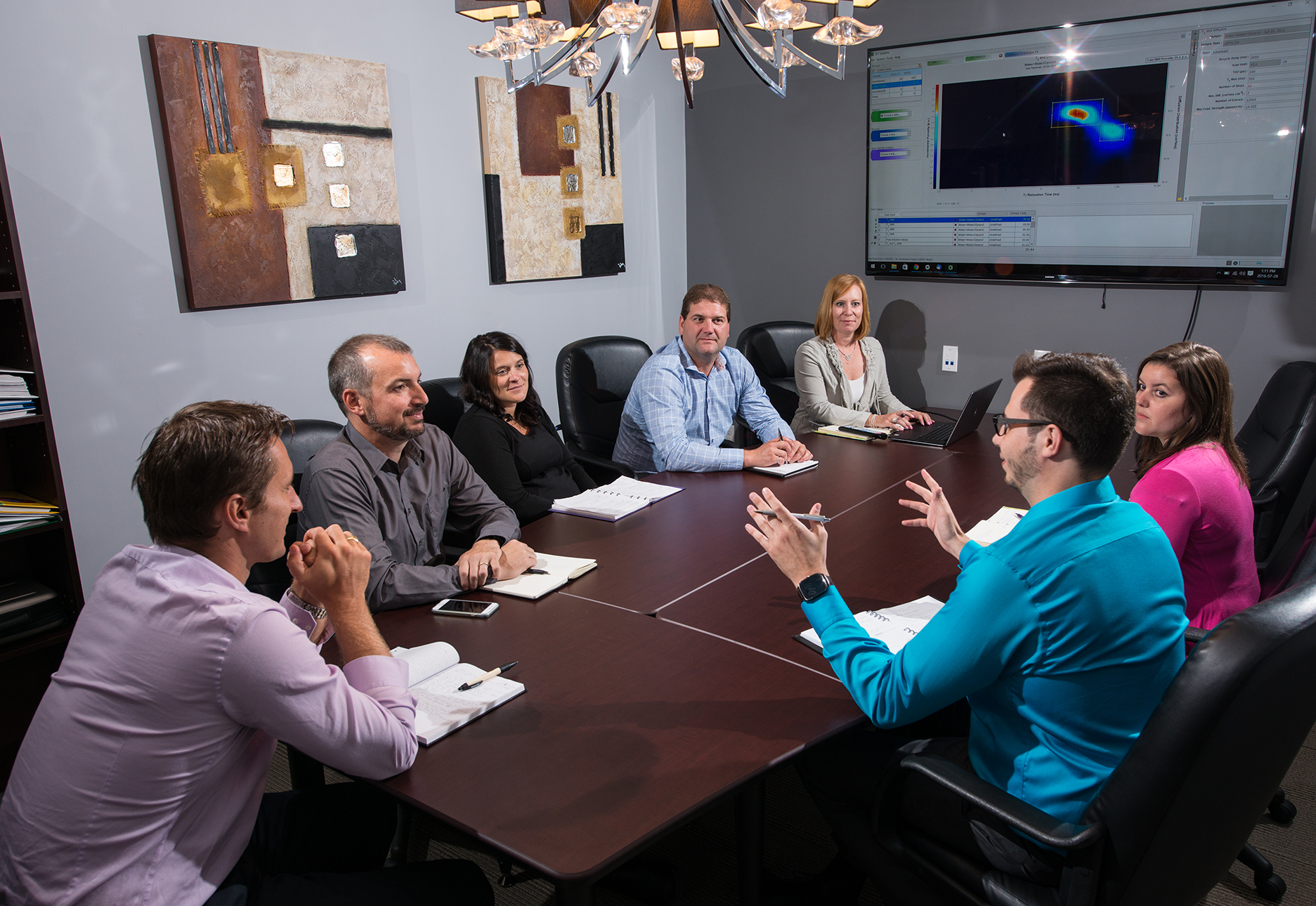 GIT's team of NMR leaders discussing a special core analysis project at the boardroom table
